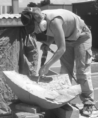 Chisseling a headstone